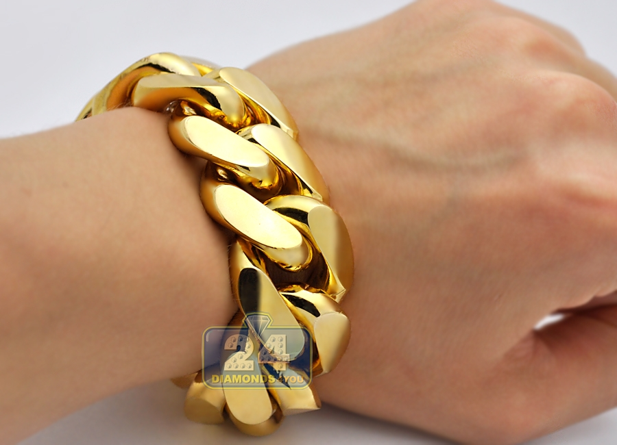 white isolated image on gold thick bracelet stock photo